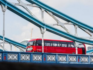 A London Bus crossing Tower Bridge